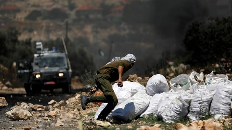 Israeli troops kill 2 Palestinians in West Bank clashes