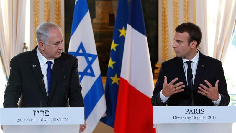 Macron was criticised for inviting Netanyahu to Paris [Stephane Mahe/Pool/AFP]