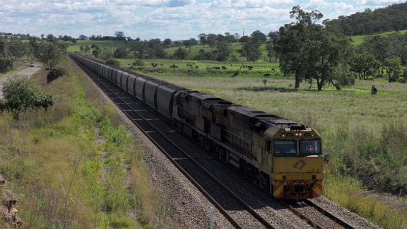 An Aurizon coal train travels through the countryside in Muswellbrook, north of Sydney [Jason Reed/Reuters]