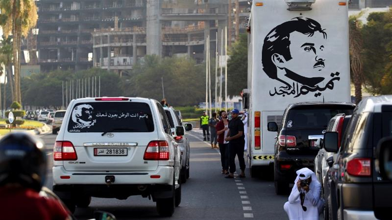 A painting depicting Qatar's Emir Sheikh Tamim Bin Hamad Al-Thani is seen on a bus during a demonstration in support of him in Doha, Qatar [Naseem Zeitoon/Reuters]
