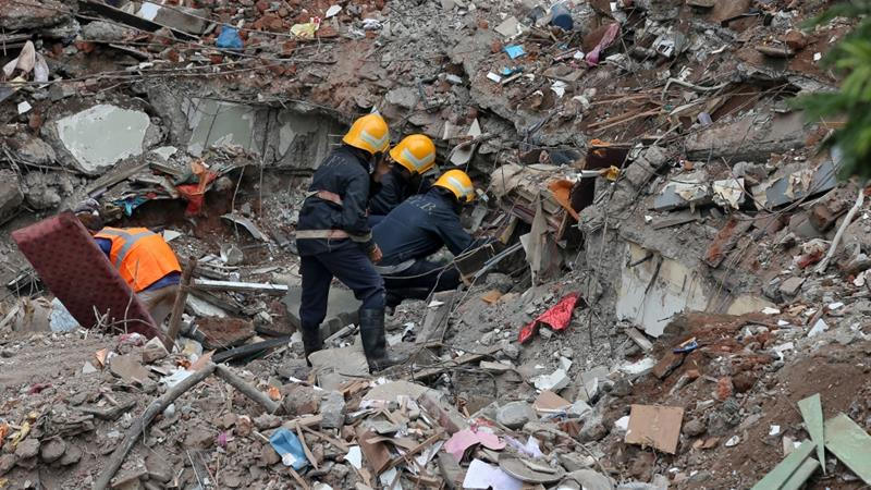 Rescuers sift through the debris in the hope of finding more survivors in the block of apartments [Reuters]