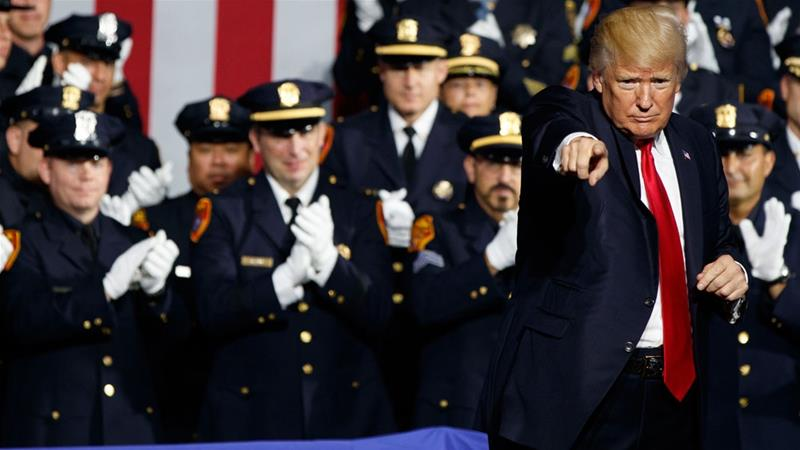 Several police cheered Trump as he endorsed the use of excessive force against suspects [Evan Vucci/AP]