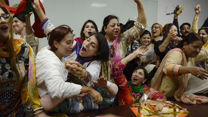 Opposition activists celebrate the Supreme Court's decision against Nawaz Sharif [AFP]