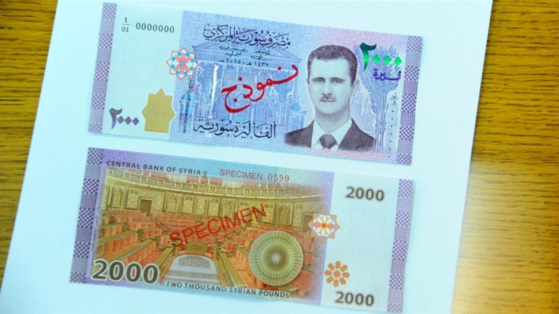 The currency previously only carried images of historic icons or pictures of Assad's late father [Reuters]