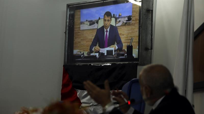 Mohammed Dahlan is seen on a screen as he attends via a video conference from the UAE an urgent parliamentary session on the situation in Jerusalem [Mohammed Salem/Reuters]