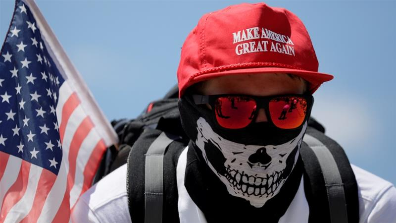A demonstrator in a 'Make America Great Again' hat listens to speeches as 'white nationalists',  white supremacists and 'alt-right' activists gather in Washington in June 2017 [Jim Bourg/Reuters]
