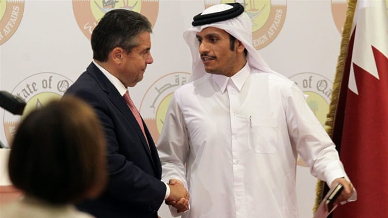 Sigmar Gabriel, left, said Germany's intelligence service would participate in efforts to clear up the accusations by Qatar's neighbours [Naseem Zeitoon/Reuters]