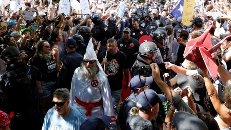 City officials said about a 1,000 people were present, of whom 50 were KKK members [Jonathan Ernst/Reuters]
