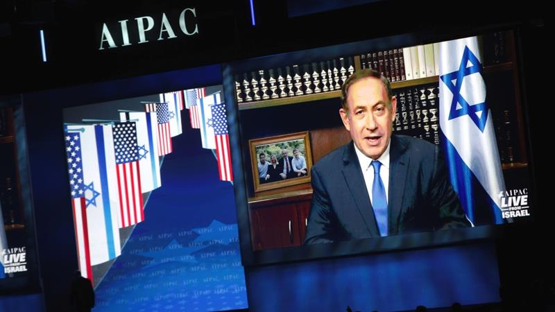 Israeli Prime Minister Benjamin Netanyahu speaks via a video link from Israel to the American Israel Public Affairs Committee (AIPAC) policy conference in Washington [Joshua Roberts/Reuters]