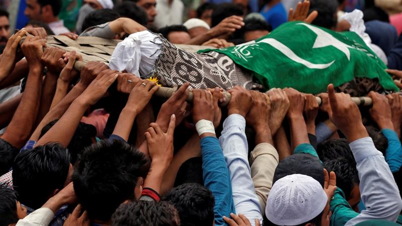 People in the village of Gabarpora carry the remains of Akeel Ahmad Bhat, a civilian who died following clashes between Kashmiri fighters and Indian security forces [Danish Ismail/Reuters]