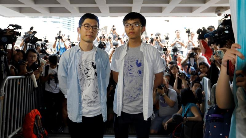 Student leaders Law and Wong were jailed for six and eight months respectively [Reuters]