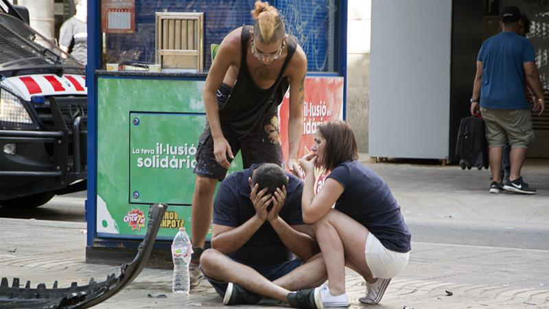 Injured people react after a van crashed into pedestrians in Las Ramblas, downtown Barcelona, on Thursday [David Armengou/EPA]