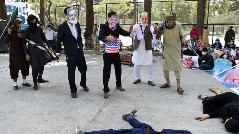 Members of the Afghan Solidarity NGO protest against the Afghan government, US and Taliban [File: AFP]