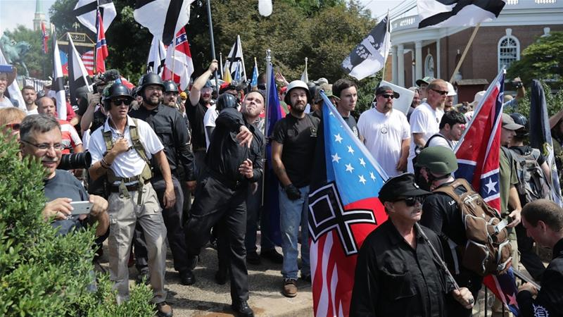 Hundreds of white nationalists, neo-Nazis, KKK and members of the 'alt-right' march in Charlottesville in 2017 [File: Chip Somodevilla/Getty Images/AFP]