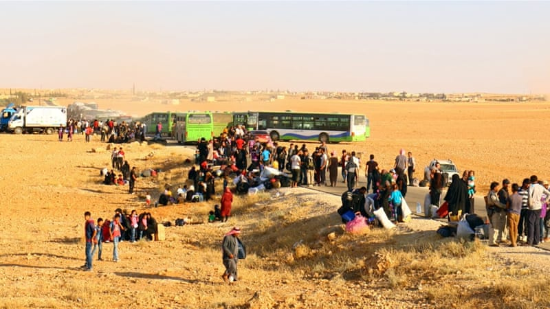 Syrian fighters, refugees arrive in rebel-held Idlib