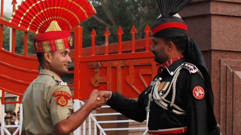 A Pakistani Ranger Right And An Indian Border Security Force Officer During The Daily