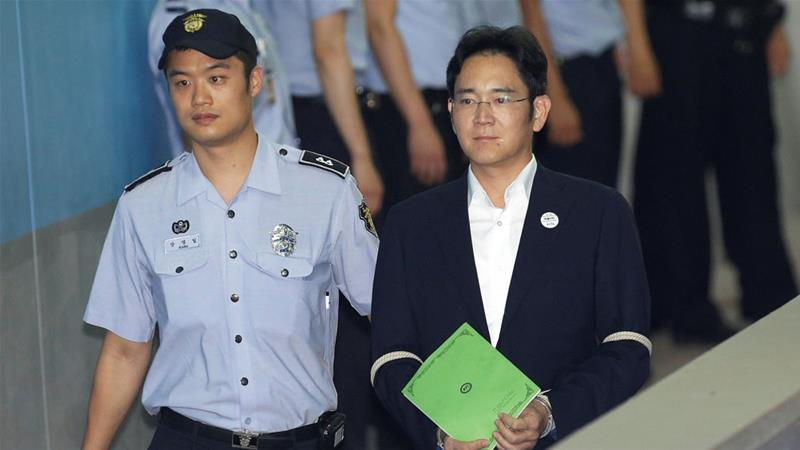 Lee (R) is on trial for charges ranging from embezzlement to perjury [Ahn Young-joon/Reuters]
