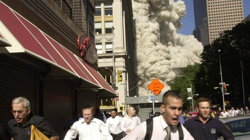 People run from the collapse of World Trade Center on Tuesday September 11, 2001 in New York City [Suzanne Plunkett/AP]