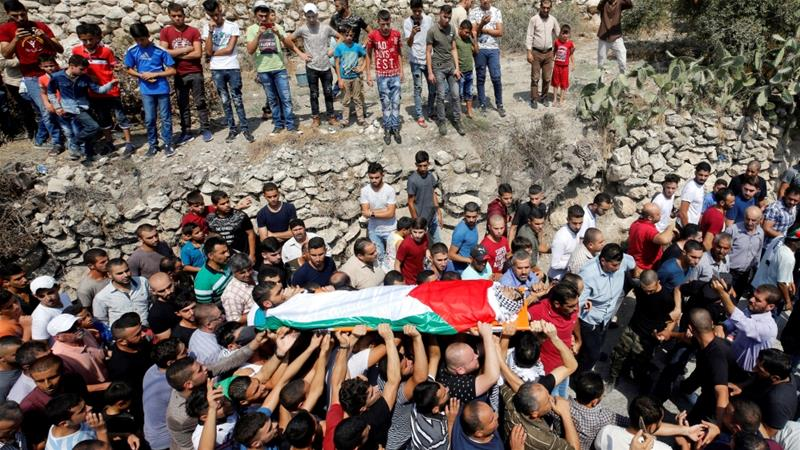 The prosecution's decision to bury the bodies without the approval of Israel's Supreme Court was a result of heavy political pressure on the military authorities [Abed Omar Qusini/Reuters]