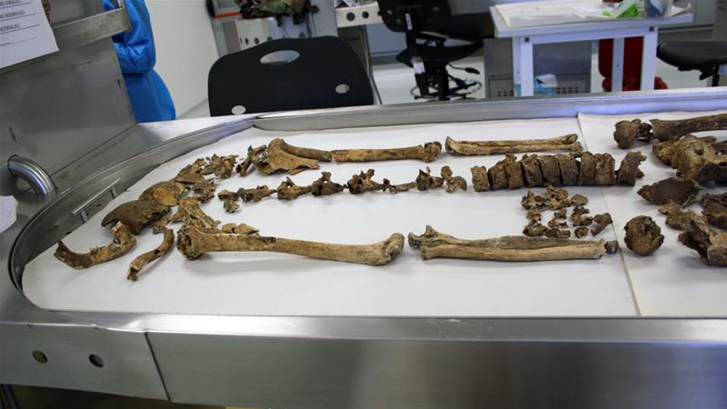 A skeleton is laid out in anatomical position in a human identification laboratory in Bogota [Chantal Flores/Al Jazeera]