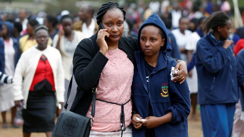 A parent embraces a student following the fire [Baz Ratner/Reuters]