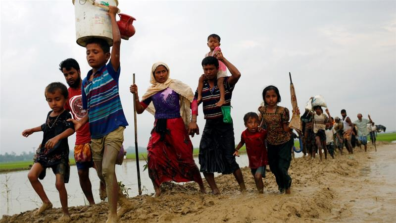 More than 120,000 Rohingya Muslims have fled to Bangladesh in the last two weeks [Mohammad Ponir Hossain/Reuters]