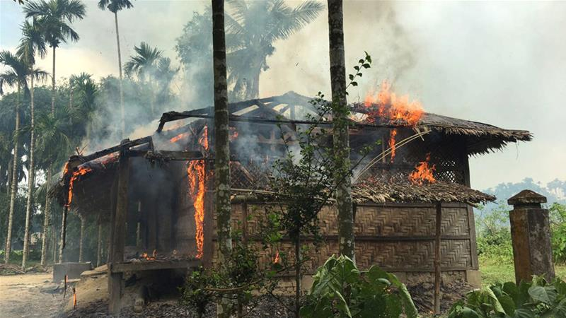 An image of a house on fire in Gawdu Zara village northern Rakhine state on Thursday