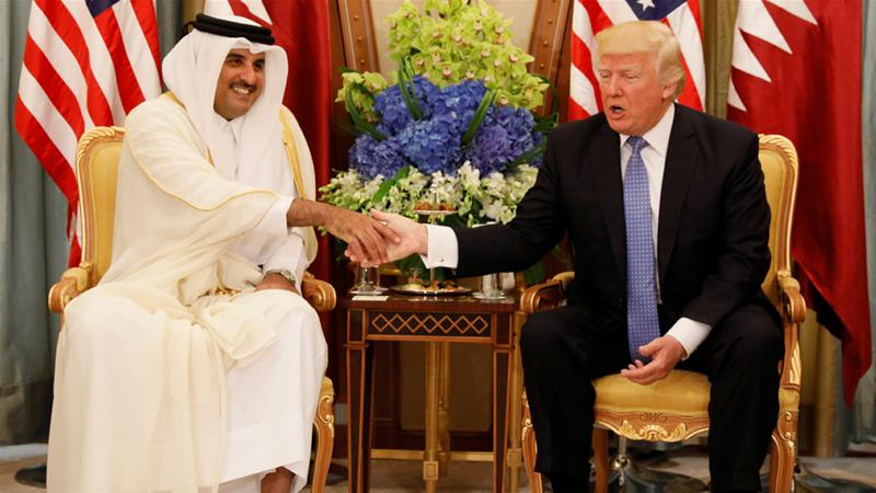 Emir Tamim bin Hamad Al Thani meets US President Donald Trump in Saudi Arabia in May 2017 [Jonathan Ernst/Reuters]