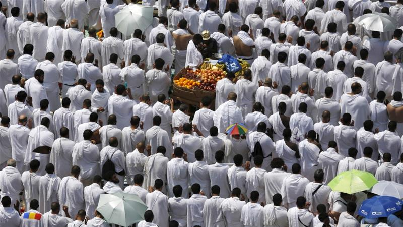Muslim pilgrims perform prayers in Arafat during the annual Hajj pilgrimage, outside Mecca [File: Ahmad Masood/Reuters]