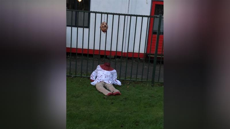The neck and the head of the doll were smeared with a red substance [AT5]