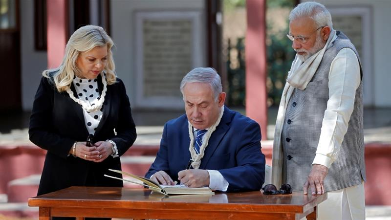 Israeli Prime Minister Benjamin Netanyahu writes a message in the visitor's book at Gandhi Ashram in Ahmedabad, India on January 17  [Reuters/Amit Dave]