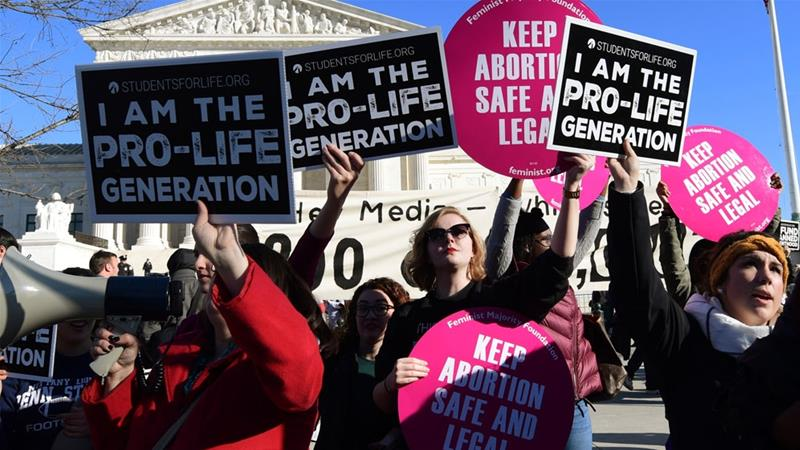 Protesters on both sides of the abortion issue gather outside the Supreme Court in Washington, Friday, Jan. 19, 2018, during the March for Life [Susan Walsh/AP Photo]