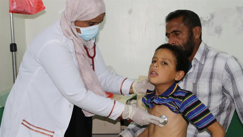 A pediatrician checks a boy infected with diphtheria in Yemen's southern port city of Aden in December, 2017 [File: Fawaz Salman/Reuters]