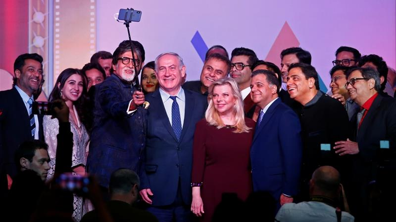 Bollywood actor Amitabh Bachchan takes a photo with Israeli PM Benjamin Netanyahu and other Bollywood personalities during 'Shalom Bollywood' event in Mumbai on January 18 [Reuters/Shailesh Andrade]