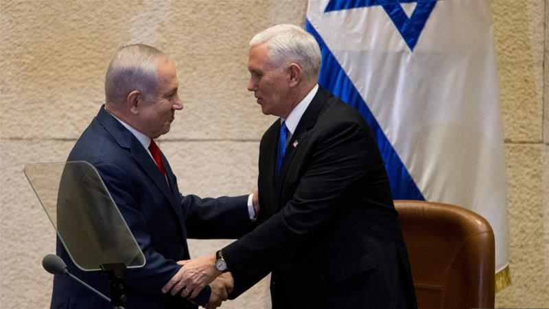 US Vice President Mike Pence shakes hands with Israeli Prime Minister Benjamin Netanyahu before his Knesset address [Ariel Schalit/Reuters]