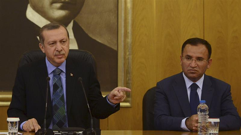 Deputy Prime Minister Bekir Bozdag (right) warned the US to stop supporting the Kurdish YPG in Manbij [File: Reuters]