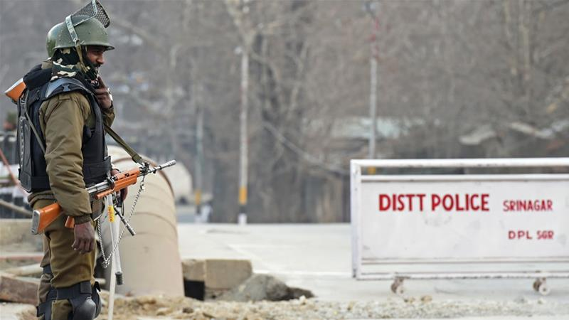 An Indian paramilitary trooper stands guard in Srinagar on January 25 [Tauseef Mustafa/AFP]