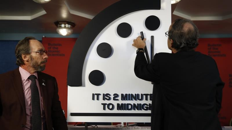 Robert Rosner, chairman of the Bulletin of the Atomic Scientists, moves the minute hand of the Doomsday Clock to two minutes to midnight [Carolyn Kaster/The Associated Press]