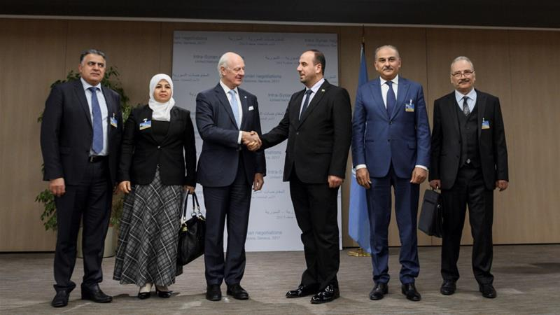 UN Special Envoy for Syria Staffan de Mistura shakes hands with head of the Syrian Negotiation Commission Nasr al-Hariri in Geneva on November 28, 2017 [Reuters/Fabrice Coffrini]