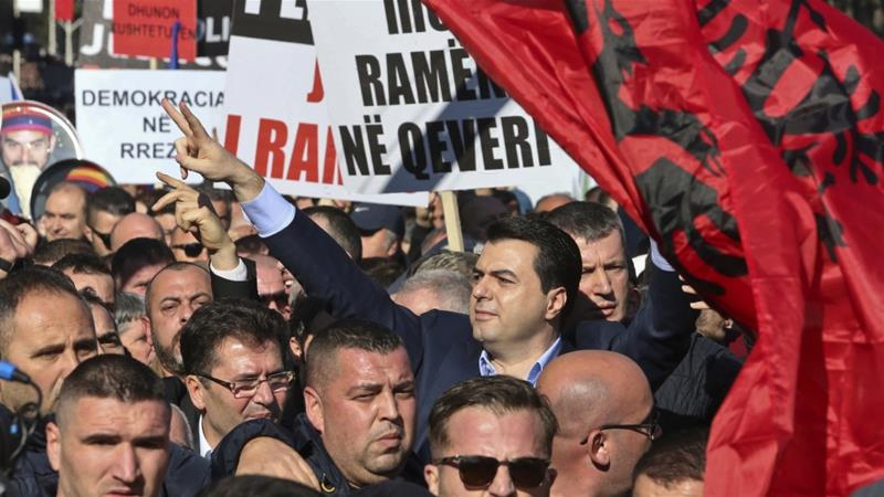 Opposition supporters call on Prime Minister Edi Rama to resign in Tirana [Visar Kryeziu/AP]