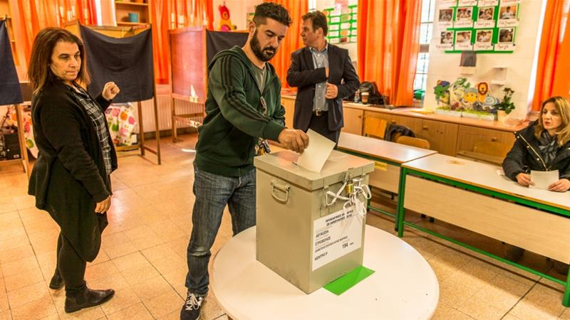 Greek Cypriots head to the polls to pick their next president
