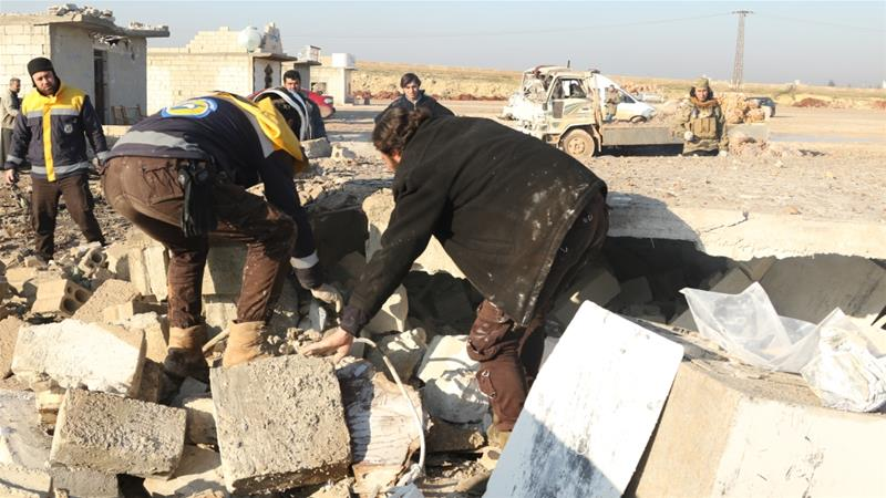 Syrian Civil Defence workers help at a site in Idlib shortly after it is struck by an air raid [Anadolu]