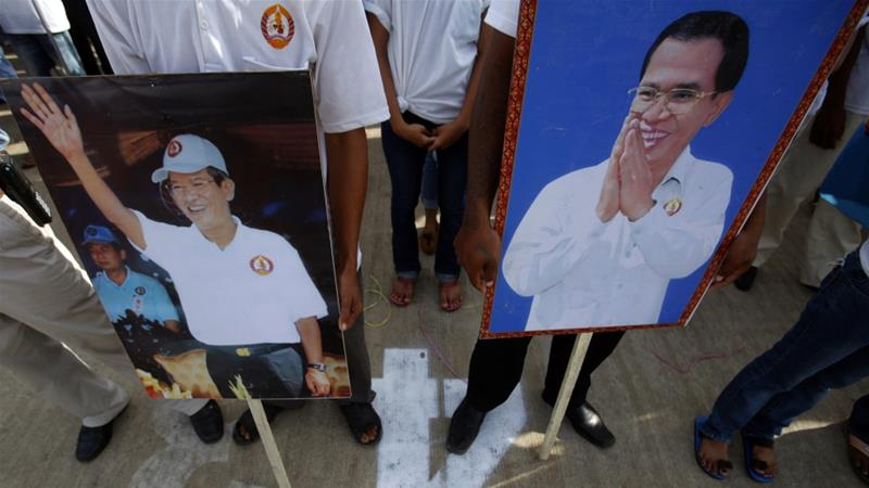 Sam Sokha was charged with insulting a public official after she threw a shoe at image of Hun Sen [Reuters]