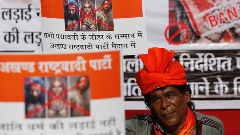 A member of the Rajput community holds a placard during a protest against the release of 'Padmaavat' in Mumbai, India on January 20, 2018 [Danish Siddiqui/Reuters]
