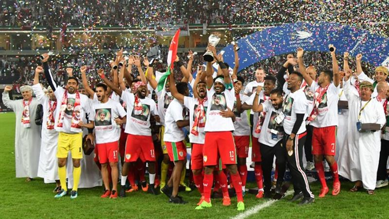 Oman's players celebrate after winning the 2017 Arabian Gulf Cup final [File: Giuseppe Cacace/AFP]
