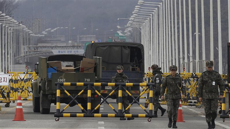 South Korean soldiers walk on the Unification Bridge that leads to the demilitarised zone with North Korea [Ahn Young-joon/AP]