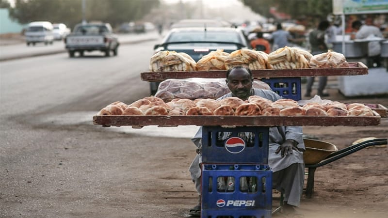 Bread prices have almost doubled in Sudan since the government stopped importing wheat from overseas [Mosa'ab Elshamy/AP]