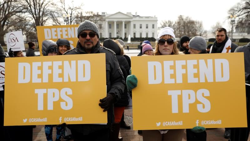 Demonstrators outside the White House protest against the termination of Salvadorans' TPS [Kevin Lamarque/Reuters]