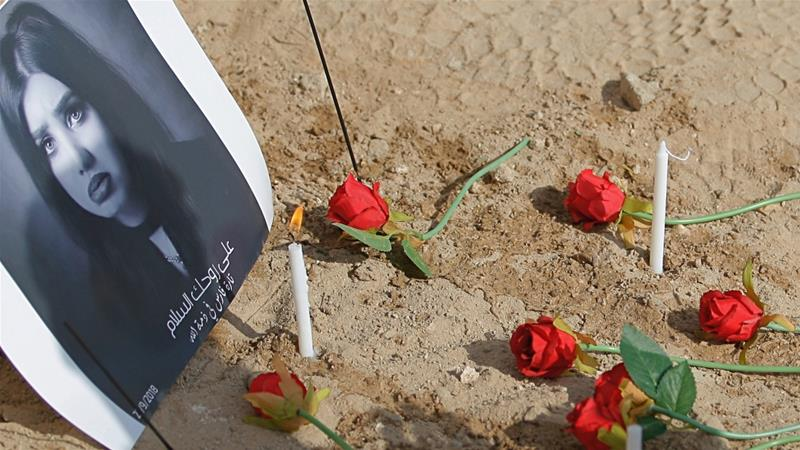 Fans of slain former beauty queen, fashion model and social media star Tara Fares leave flowers and candles at her gravesite, in Najaf, Iraq  October 1, 2018 [Anmar Khalil/AP]
