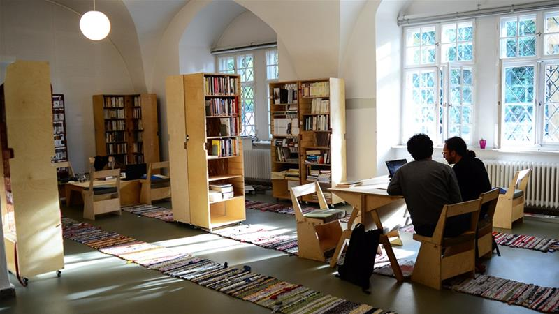 The project first opened in February 2017 in a refugee shelter. It was moved to the ground floor of Berlin's central library this year [Marta Vidal/Al Jazeera]